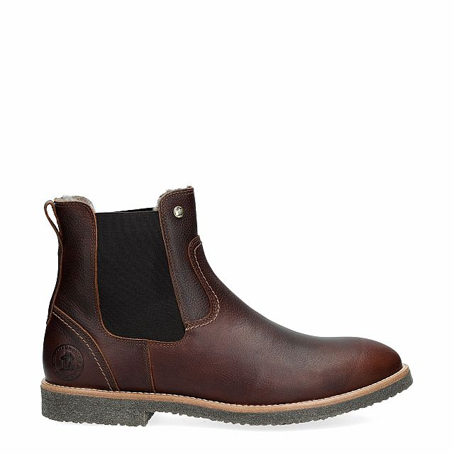 Leather ankle boot in chestnut with a lining of natural fur