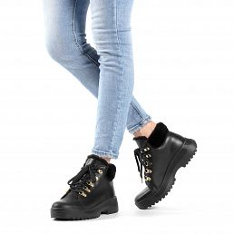 Black leather women's sneaker boot with a fur lining