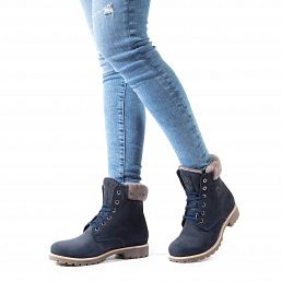 Leather women's boot in navy with a lining of natural fur