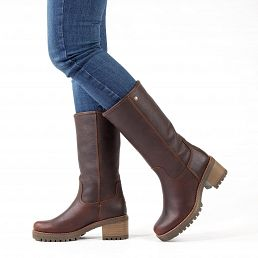 Leather women's boot in chestnutbrown with a fur lining