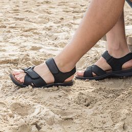 Black leather sandals with a lycra lining